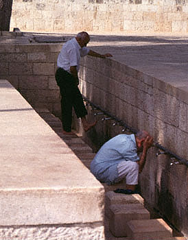 Muslim men wash hands and feet on the Temple Mount in Jerusalem