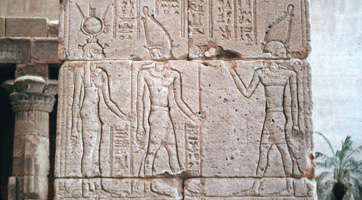 Deities carved in the wall of an Egyptian temple